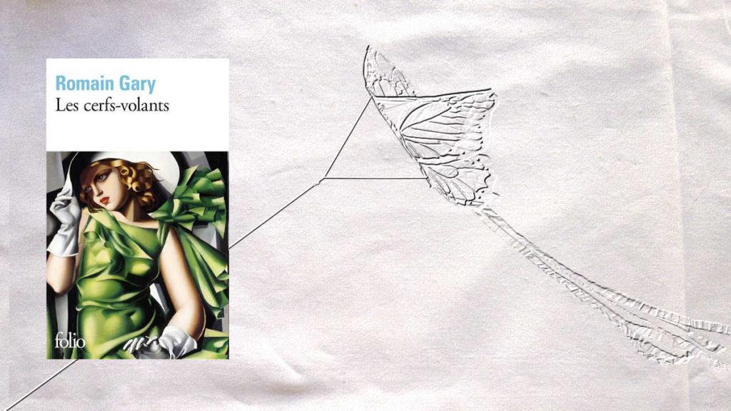 A l'arrière plan, une cerf-volant et au premier plan, la couverture du livre de Romain