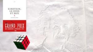 En arrière plan, Albert Einstein et au premier plan un Rubik's cube et la couverture du livre d'Olivier Liron, Einstein, le sexe et moi