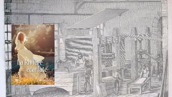 A l'arrière plan, travail du papier à la main, au premier plan la couverture du livre de Jacqueline Lefort, La rivière écarlate